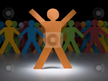 Yellow paper figure stock photo, A orange paper figure stands under the spotlight in front of multicolor crew. by Ignacio Gonzalez Prado