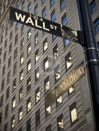 Wall Street stock photo, A Wall Street sign when it crossover with Broadway in Manhattan New York. by Ignacio Gonzalez Prado