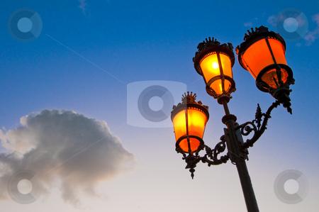 Streetlamp stock photo, One of the many streetlamps located at es Born Square, Ciutadella, Minorca Island. by Anibal Trejo