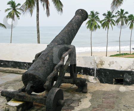 Rusty cannon on Elmina Fort in Ghana stock photo, Elmina Castle was the exit port for slaves from Ghana in Africa. This is one of the old rusted cannons by Steven Heap