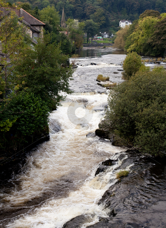 River runs rapidly through Llangollen in Wales stock photo, Rapids on River Dee in Llangollen in Wales by Steven Heap