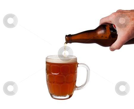 Beer being poured from bottle into pint stock photo, Golden ale being poured from brown bottle into english pint mug by Steven Heap