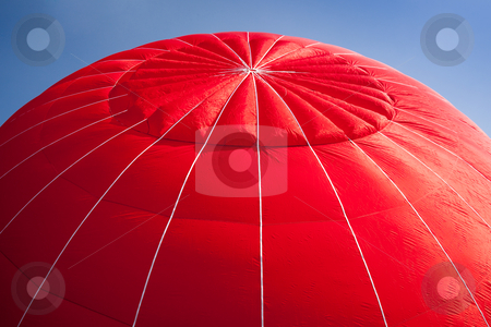 Hot air balloon - red stock photo, Red canopy of hot air balloon being inflated against a bright blue sky by Steven Heap