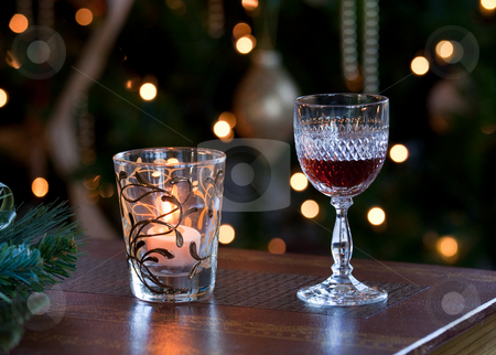 Glass of sherry with candle stock photo, Glass of sherry or port in front of out of focus christmas tree and lit by a candle by Steven Heap
