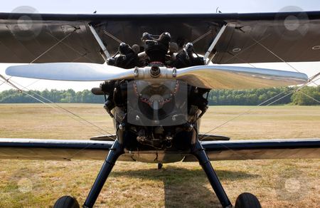 Propeller and engine of old biplane stock photo, Close up of the engine and propellor of antique biplane by Steven Heap