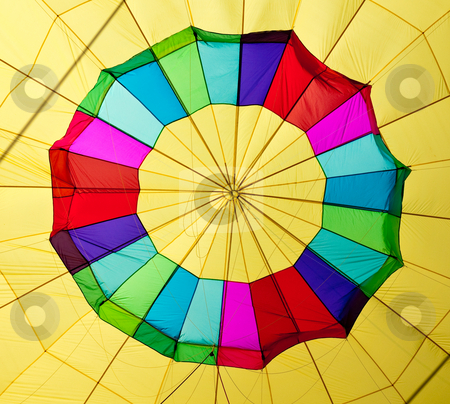 Hot air balloon center stock photo, Center of a colorful hot air balloon being inflated by Steven Heap