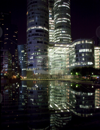Reflection of La Defense Office buildings at night stock photo, Modern skycraper office buildings reflected at night at La Defense in Paris by Steven Heap