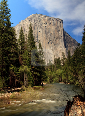 Slow motion river in front of El Capitan stock photo, Yosemite view with slow shutter speed providing smoothed calm waters of rushing river by Steven Heap