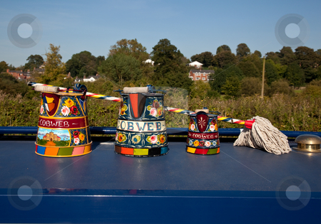 Hand painted traditional decorated watering cans stock photo, Canal life in England with traditionally decorated tools on display by Steven Heap