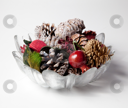 Glass vase holding scented cones stock photo, Christmas or thanksgiving decoration with scented cones and nuts in a glass vase by Steven Heap