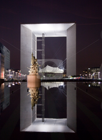 Reflection of the Grande Arche in Paris at night stock photo, La Grande Arche at La Defense reflected in the pool at night by Steven Heap