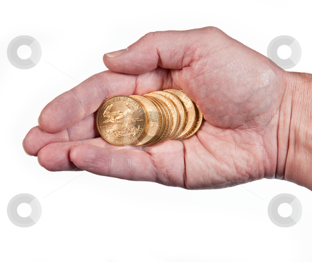 Hand holding a stack of gold coins stock photo, Male hand holding a stack of pure gold eagle coins by Steven Heap