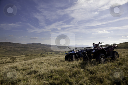 Pair of ATV quad bikes on lonely mountain stock photo, Adventure on power bikes on remote moorland in Wales by Steven Heap