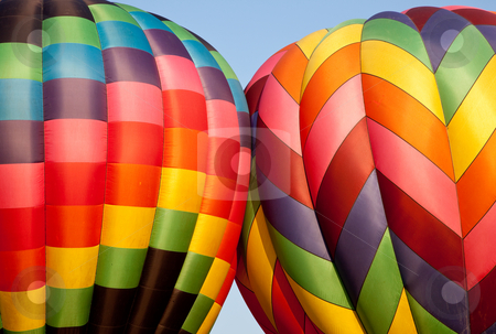 Two Hot air balloons bumping stock photo, Canopies of two hot air balloons bounce against each other during inflation by Steven Heap