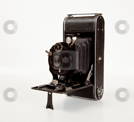 Ancient Camera in side view stock photo, Antique bellows camera in side view isolated on white by Steven Heap