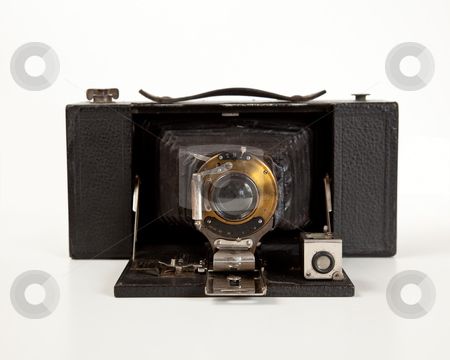 Ancient Camera in front view stock photo, Antique bellows camera in front view isolated on white by Steven Heap