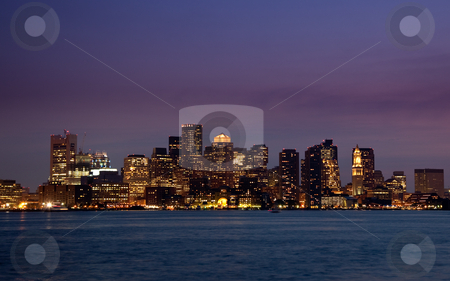 Panorama of Boston Skyline at night stock photo, Illuminated skyscrapers of Boston at night, reflected in the water of the Charles River by Steven Heap