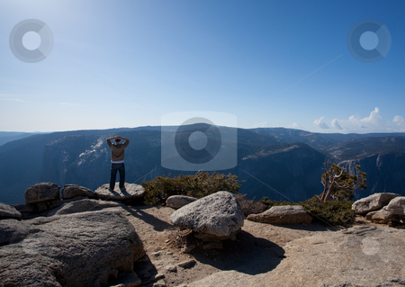 Male hiker looking at view from Yosemite Peak stock photo, View from Sentinel Point over Yosemite valley by Steven Heap