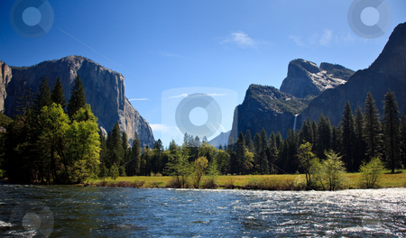 Yosemite valley with Merced river stock photo, View into Yosemite valley over a shining Merced river showing entrance waterfalls by Steven Heap