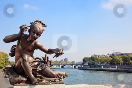 Small child statue frames view of Seine and Paris stock photo, View of the Seine from Pont Alexandre III framed by small impish statue by Steven Heap