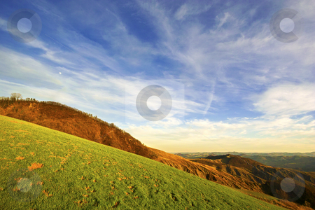 ... on a green field stock photo, ... almost lost on a hill top by emiliano beltrani