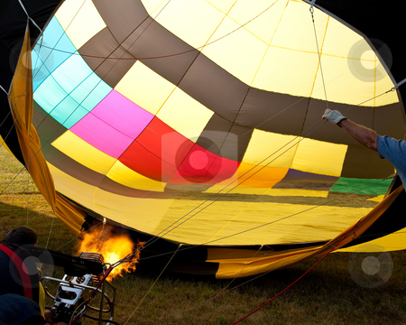 Hot air balloon inflation with flames stock photo, Burner of hot air balloon sending the heat into the canopy by Steven Heap