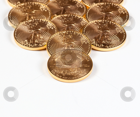 Receding stack of gold coins stock photo, Golden Eagle coins forming a receding stack into the background by Steven Heap
