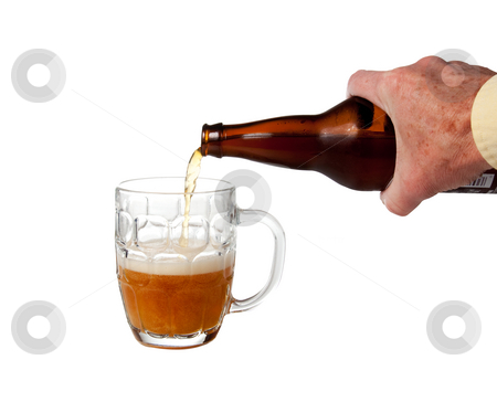 Beer being poured from bottle stock photo, Golden ale being poured from brown bottle into half full english pint mug by Steven Heap