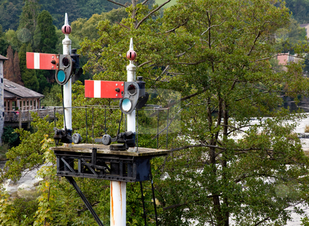 Old railway semaphore signals at Llangollen station stock photo, Railway signals at stop using the obselete semaphone system in Llangollen in Wales by Steven Heap