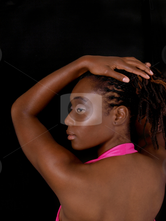 Young black woman profile portrait pink dress stock photo, Young African American Woman profile portrait showing back by Jeff Cleveland