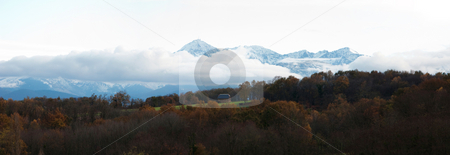 Countryside landscape stock photo, 23 megapixels panoramic view of a the pyrenees mountains range in the clouds by Laurent Dambies