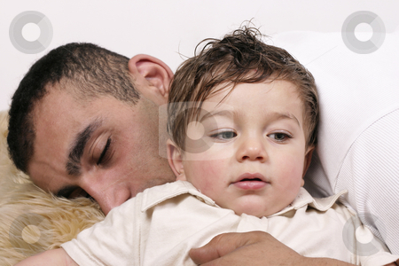 Father and son stock photo, Father and son relaxing on a rug by Leah-Anne Thompson