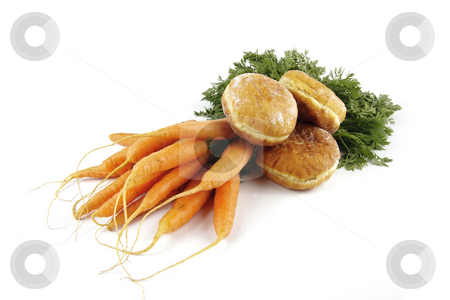 Carrots and Doughnut stock photo, Contradiction between healthy food and junk food using bunch of carrots and doughnut on a reflective white background by Keith Wilson