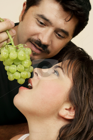 Friendship stock photo, Playfully offers her grapes by Leah-Anne Thompson