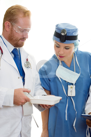 Two Health care professionals stock photo, Two healthcare professionals at work by Leah-Anne Thompson