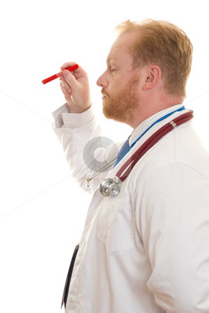 Doctor with exam light stock photo, Doctor with an examination light by Leah-Anne Thompson