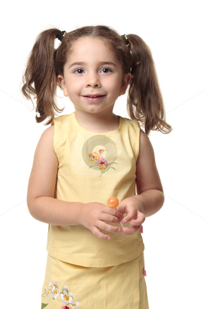 Pretty girl holding candy sweet stock photo, Pretty young toddler girl holding a sweet lollipop and smiling. by Leah-Anne Thompson