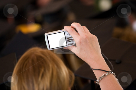 Digital Point and Shoot stock photo, A woman taking a picture with a digital point and shoot camera.  The clipping path for the lcd screen is included.  Shallow depth of field. by Todd Arena