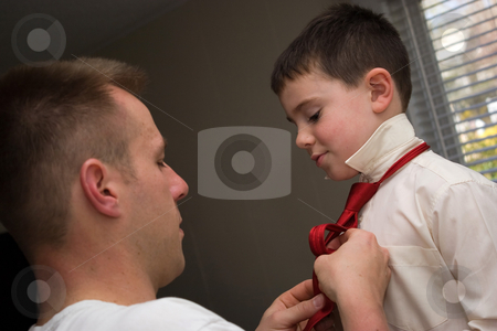 Father and Son stock photo, A young dad helps his son get ready by helping him tie his neck tie. by Todd Arena