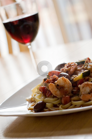 Shrimp Pasta Dish stock photo, A delicious shrimp and pasta dish along with a glass of red wine. Shallow depth of field. by Todd Arena
