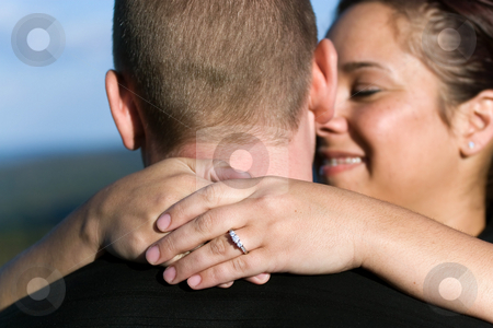 Engaged Couple stock photo, A young happy couple that just got engaged.  Shallow depth of field with focus on the diamond engagement ring. by Todd Arena