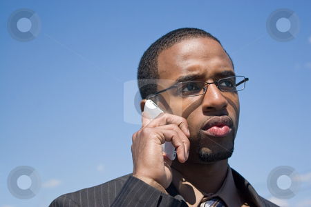 Concerned Business Man stock photo, A young African American man talking on his cellular phone with a concerned or serious look on his face. by Todd Arena