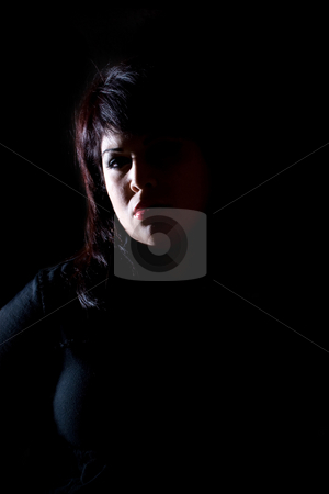 Glamorous Girl stock photo, A serious young hispanic woman under dramatic lighting. by Todd Arena