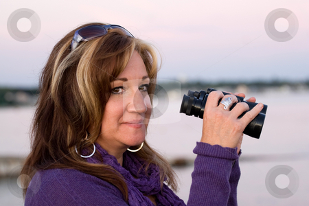 Woman with Binoculars stock photo, A woman looking with binoculars at the beach. by Todd Arena