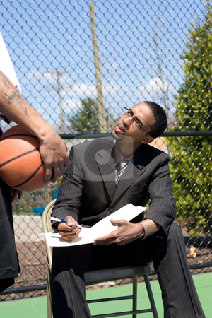 Basketball Coaching stock photo, A confident coach speaking to one of his players on the basketball team. by Todd Arena