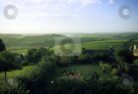 English Countryside stock photo, View over lush green  english countryside in summer with a cottage garden in the foreground by Steven Heap
