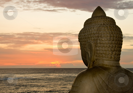 Buddha and sunset stock photo, Side view of Buddha overlooking the setting sun by Steven Heap