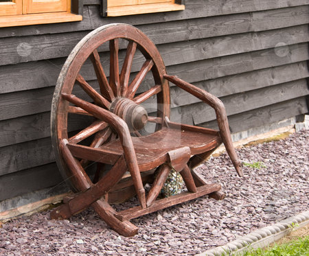 Rustic Chair stock photo, Rustic wooden chair made from an old cart wheel by Steven Heap