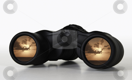Binoculars with rosy sunset view stock photo, Binoculars showing a rosy sunset giving an illustration of a secure future or a happy retirement by Steven Heap
