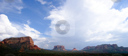 Panorama of Sedona Rocks stock photo, Wide view of Sedona with a dramatic sky by Steven Heap